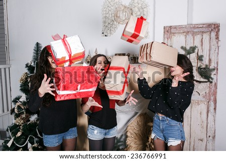 Beautiful girl throw up Christmas gifts. Decorative vintage apartment. cookies - stock photo