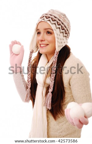 Beautiful girl throwing snowball on white background - stock photo