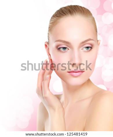 Beautiful Girl Touching Her Face - stock photo