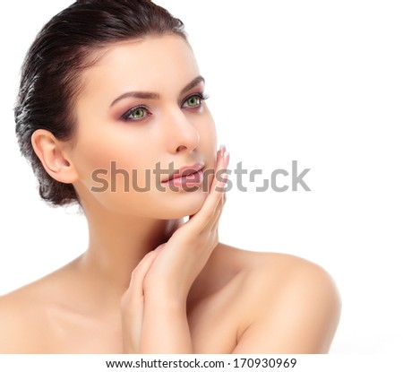 Beautiful Girl Touching Her Face. Isolated on a White Background. Perfect Skin. Beauty Face. Professional Makeup  - stock photo