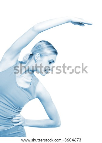 Beautiful girl training fitness isolated on white (toned in blue) - stock photo