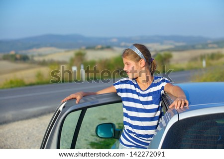 Beautiful girl traveling by car. Vacations in Tuscan. Italy