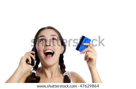 Beautiful girl uses her credit card to make an online transaction - stock photo