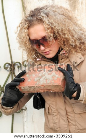 Beautiful girl viewing the brick