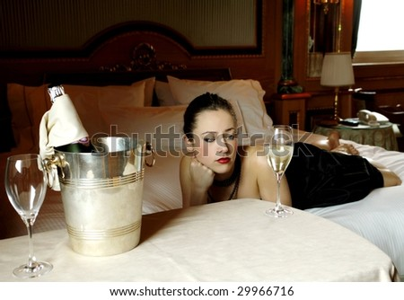 beautiful girl waiting for someone with champagne on ice - stock photo