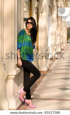 Beautiful girl walking in a shop - stock photo