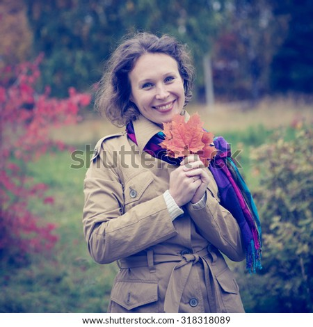 Beautiful girl walking in the autumn park. - stock photo