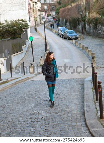 Beautiful girl walking on the Motmartre in city of Paris, France