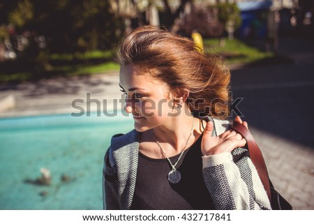beautiful girl walking park - stock photo