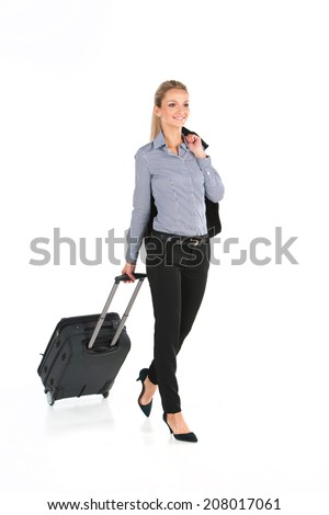 beautiful girl walking with luggage and smiling. young girl holding jacket on white background - stock photo