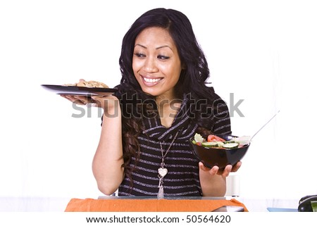 Beautiful Girl Watching her Weight Deciding to Eat Salad or Cookies - stock photo