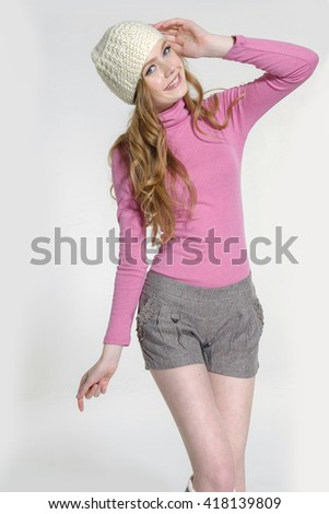 Beautiful girl wearing a white beret. posing - stock photo