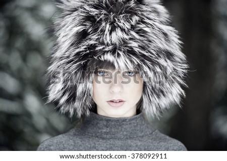 Beautiful girl wearing fur hat - stock photo