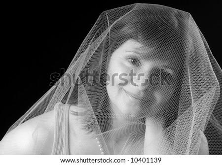 Beautiful girl wearing gauze dreaming of being a bride - stock photo