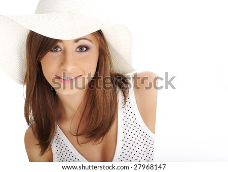Beautiful girl wearing white hat  holding empty white board