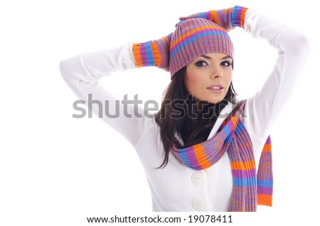 Beautiful girl wearing winter hat and gloves and scarf - stock photo