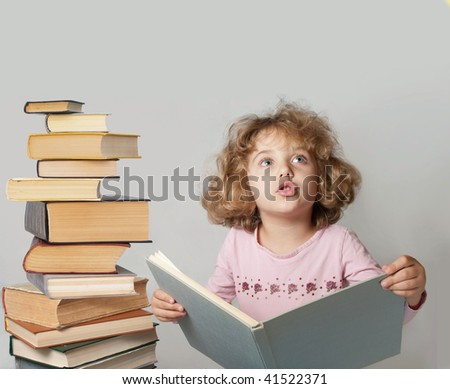 beautiful girl with a book in hand - stock photo