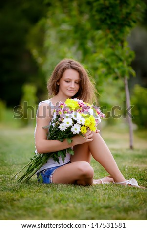 beautiful girl with a bouquet of flowers - stock photo