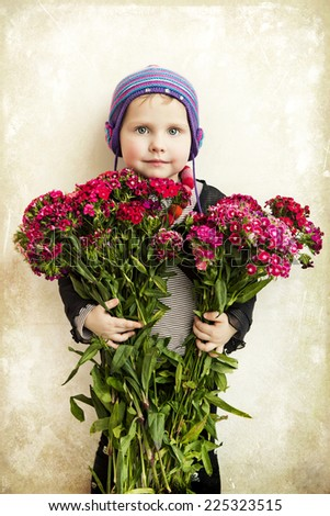 Beautiful girl with a bouquet of flowers in the studio - stock photo