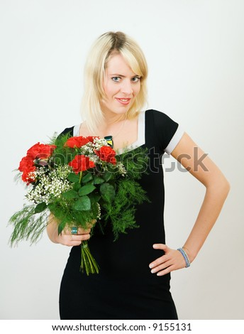 Beautiful girl with a bouquet of red roses - stock photo