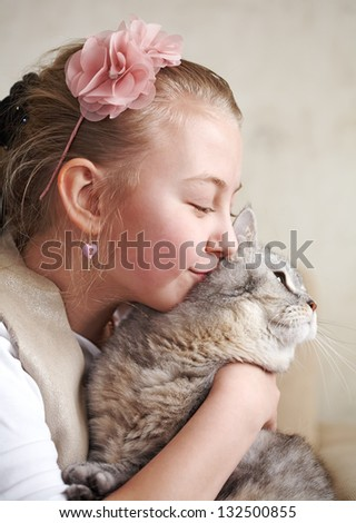 Beautiful girl with a cat - stock photo