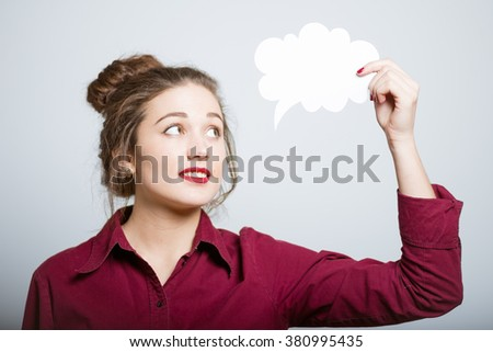 beautiful girl with a cloud of ideas, isolated on a gray background