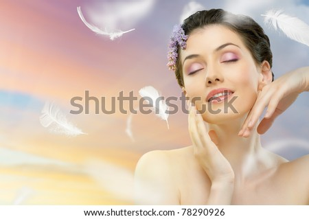 beautiful girl with a flower lilac - stock photo