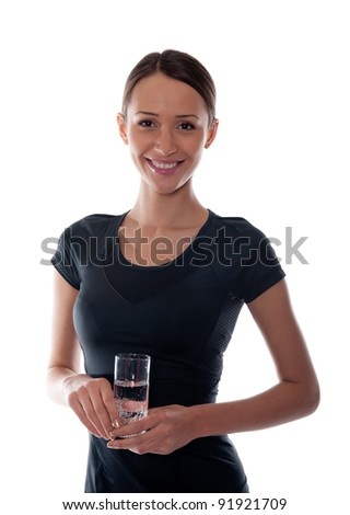 beautiful girl with a glass of water in the hands on a white background - stock photo
