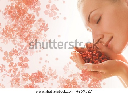 Beautiful girl with a handful of aromatic berries - stock photo