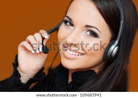 beautiful girl with a headset looking at the camera - stock photo
