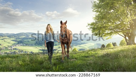 Beautiful girl with a horse in the german mountains - stock photo