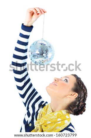 Beautiful girl with a mirror sphere on a white background. - stock photo