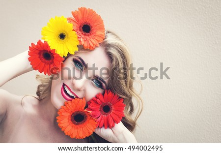 Beautiful girl with a nice flowers in hands