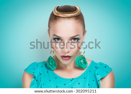 Beautiful girl with a professional makeup and stylish accessories in old-fashioned dress with polka dots. Vogue stylish look. Piercing view big seductive eyes. Golden crown halo of divinity, new idea - stock photo