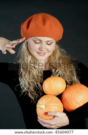 Beautiful girl with a pumpkin.