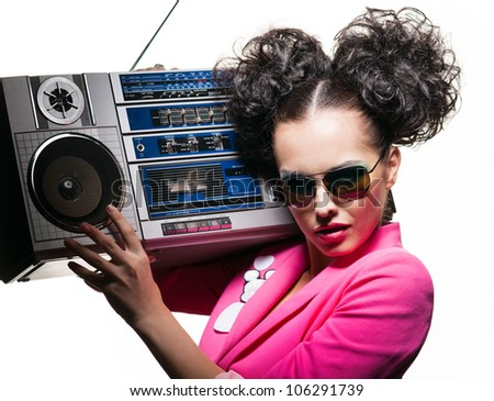 Beautiful girl with a tape recorder - stock photo