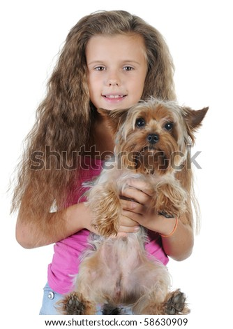 Beautiful girl with a Yorkshire terrier in her arms. Isolated on white background