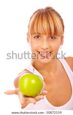 Beautiful girl with an apple, isolated on white background. - stock photo