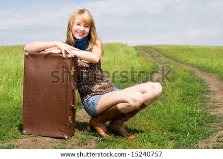 beautiful girl with an old leathern suitcase outdoor
