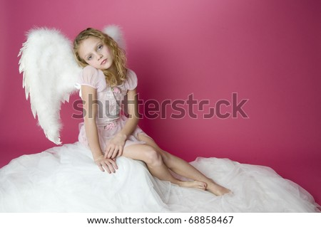 Beautiful girl with angel wings and pink dress - stock photo