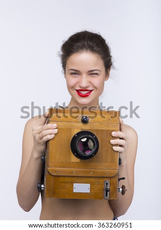 beautiful girl with antique camera