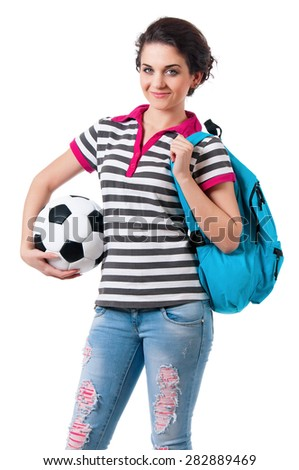 Beautiful girl with backpack and classic soccer ball, isolated on white background - stock photo