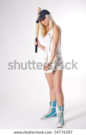 beautiful girl with bat and ball - stock photo