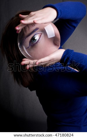 beautiful girl with big magnifying glass in hands - stock photo