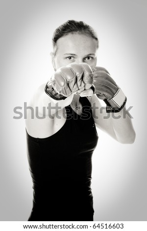 Beautiful girl with boxing gloves. Black and white. - stock photo