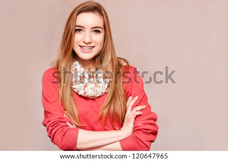 beautiful girl with braces, crossing her arms - stock photo