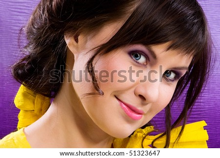 beautiful girl with bright make up on pink background - stock photo