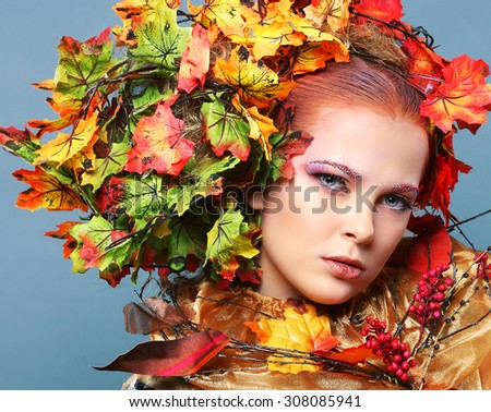 Beautiful girl with bright makeup isolated on white background. Fantasy girl portrait. Autumn fairy portrait.   - stock photo