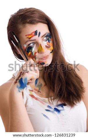 Beautiful girl with brushes. Isolated on white background. - stock photo