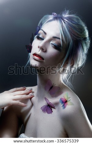 Beautiful Girl With  Butterfly. Beauty Face. Creative Make up and Hair Style. - stock photo